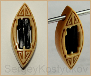 Amulet from mammoth ivory (tusk) and black tourmaline